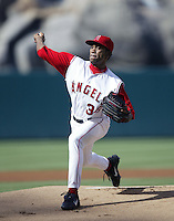 Ramon Ortiz of the Los Angeles Angels pitches during a 2002 MLB season game at Angel Stadium, in Anaheim, California. (Larry Goren/Four Seam Images)