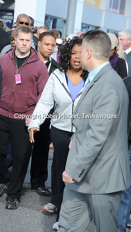 Oprah Winfrey walking at  O, The Oprah Magazine's 10th Anniversary celebration Live Your Best Life Walk on May 9, 2010 at The .Intripid in New York City.