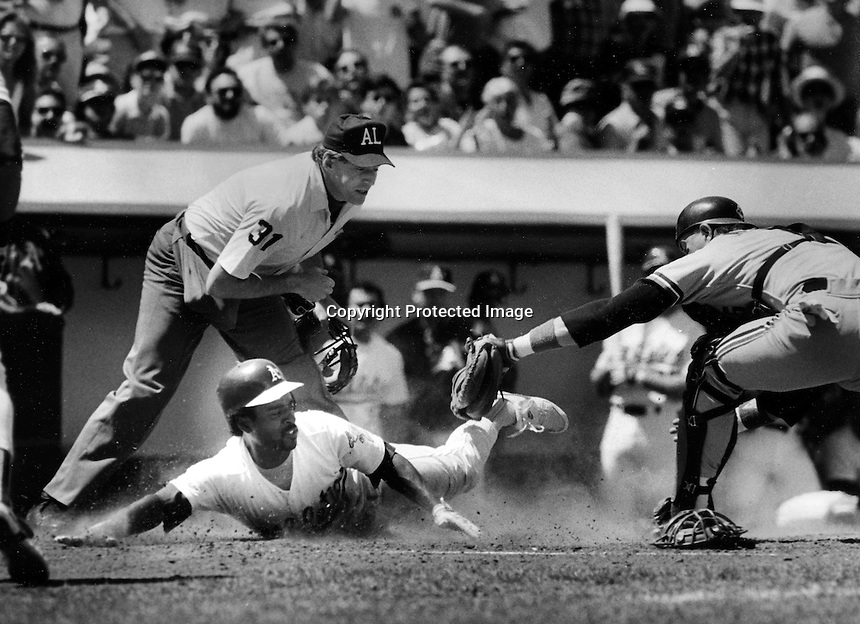 A's Tony Phillips safe at home. (1988 photo by Ron Riesterer)