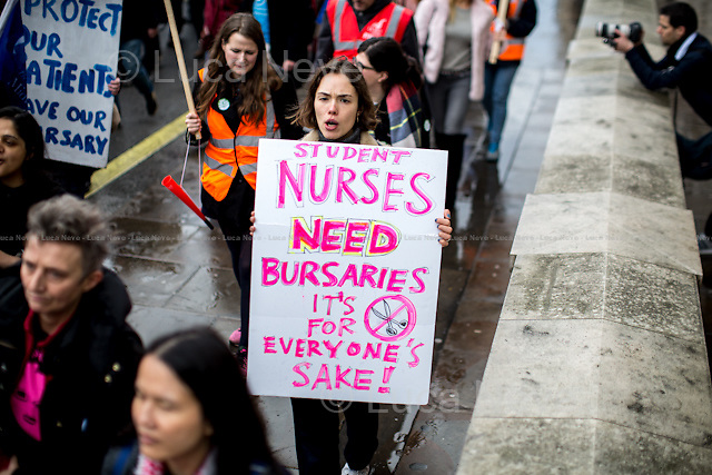 London, 09/01/2016. Today, about 5,000 people, including doctors, student nurses, midwives, junior doctors and other healthcare professionals marched from the Saint Thomas Hospital to Downing Street to protest against the Conservative Government's plan to scrap bursaries for nursing and midwifery students from 2017. The demonstration was organised by the King's College London students and supported by trade unions and other organizations fighting against the plan to privatise the NHS (National Health Service).<br />  <br /> For more information please click here: http://on.fb.me/1IWbWg9<br /> <br /> To sign the online petition please click here: https://petition.parliament.uk/petitions/113491