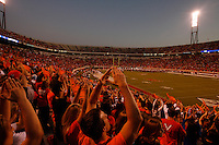 Fans celebrate at the UVa football stadium.