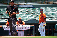 GCL Orioles manager Orlando Gomez (23) looks back towards umpire Ross Sheridan during a game against the GCL Twins on August 11, 2016 at the Ed Smith Stadium in Sarasota, Florida.  GCL Twins defeated GCL Orioles 4-3.  (Mike Janes/Four Seam Images)
