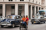 Havana, Cuba; classic 1950's Chevy cars driving down the street in Havana