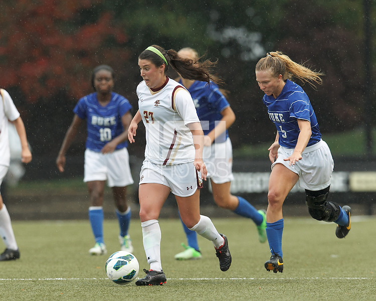 Boston College forward Hayley Dowd (27) brings the ball forward as Duke University midfielder Kaitlyn Kerr (5) closes.Boston College (white) defeated Duke University (blue/white), 4-1, at Newton Campus Field, on October 6, 2013.