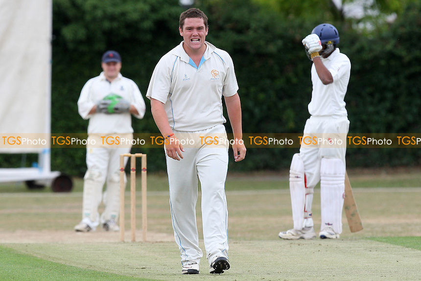 A Ison of Upminster reacts after going close to a wicket - Upminster CC vs Ilford CC - Essex Cricket League - 17/07/10 - MANDATORY CREDIT: Gavin Ellis/TGSPHOTO - Self billing applies where appropriate - Tel: 0845 094 6026