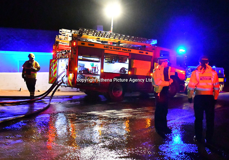 Pictured: Fire at Capestone Farm near Haverfordwest, Pembrokeshire, Wales, UK. Monday 11 December 2017<br /> Re: A fire has broken out at a poultry farm in in Walwyn's Castle, Pembrokeshire.<br /> More than 30 firefighters from Mid and West Fire Service attended Capestone farm in Haverfordwest, at 3.45pm.<br />  have been tackling the blaze at the site .<br /> The cause of the fire is not yet known. The firm said the blaze was in a barn housing vehicles and no animals had been hurt.