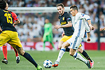 Cristiano Ronaldo (r) of Real Madrid fights for the ball with Saul Niguez Esclapez of Atletico de Madrid during their 2016-17 UEFA Champions League Semifinals 1st leg match between Real Madrid and Atletico de Madrid at the Estadio Santiago Bernabeu on 02 May 2017 in Madrid, Spain. Photo by Diego Gonzalez Souto / Power Sport Images