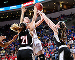 SIOUX FALLS, SD: MARCH 5: 	Allison Arens #10 from the University of South Dakota takes the ball to the basket between a pair pf defenders including Abi Lujan #21 from Nebraska Omaha during the Summit League Basketball Championship on March 5, 2017 at the Denny Sanford Premier Center in Sioux Falls, SD. (Photo by Dave Eggen/Inertia)