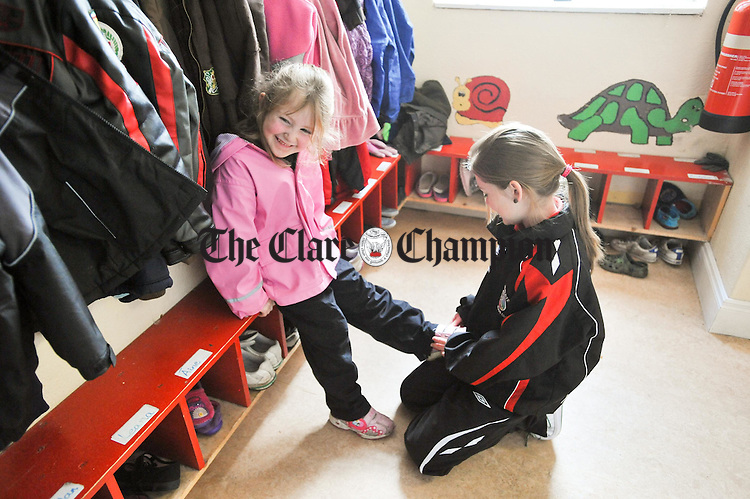 Emma Hynes gets some help with her shoe from Rebecca Burke during sos break  at Lackyle National School. Photograph by John Kelly.