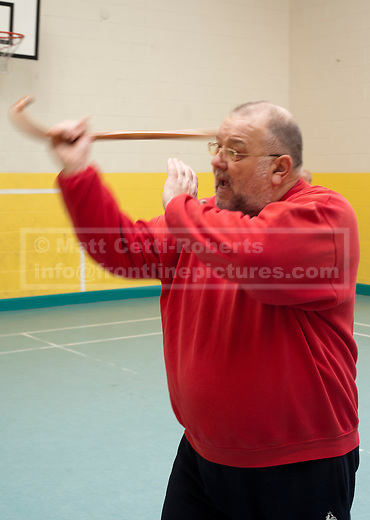 Kevin Garwood demonstrates a striking technique with an NHS walking stick. With Norfolk lacking a properly funded youth service, the idea for Cane Work came when some of his students said they wouldn't come to a tai chi lesson in Great Yarmouth because they felt threatened by the large amount of teenagers hanging around on in residential areas.