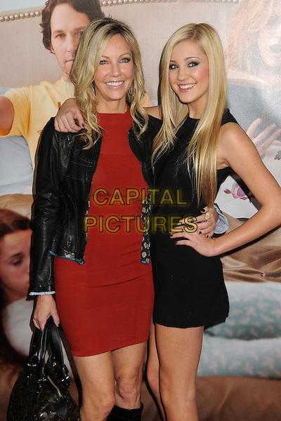 """Heather Locklear & Ava Sambora.""""This Is 40"""" Los Angeles Premiere held at Grauman's Chinese Theatre, Hollywood, California, USA..December 12th, 2012.half length black leather jacket red dress  mother mom mum daughter family hand on hip side arm over shoulder .CAP/ADM/BP.©Byron Purvis/AdMedia/Capital Pictures."""