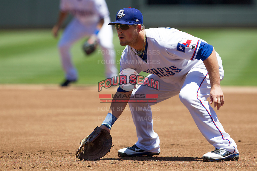 Round Rock first baseman Chris McGuiness (21) on defense against the Nashville Sounds in the Pacific Coast League baseball game on May 5, 2013 at the Dell Diamond in Round Rock, Texas. Round Rock defeated Nashville 5-1. (Andrew Woolley/Four Seam Images).