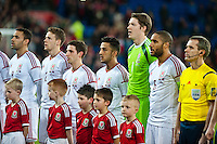 Wednesday 05 March 2014<br /> Pictured:Swans players  Ashley Williams and  and  Neil Taylor sing the Welsh national anthem<br /> Re: International friendly Wales v Iceland at the Cardiff City Stadium, Cardiff,Wales UK
