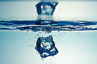 Droplet forming bubbles, underwater view, studio shot
