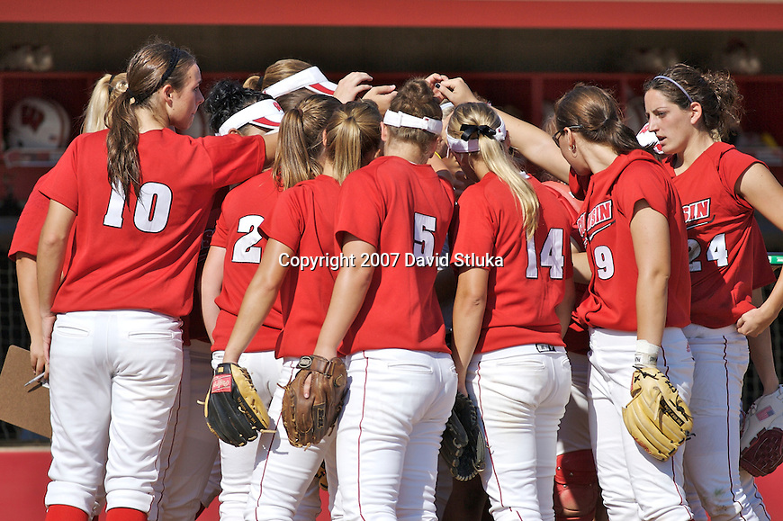 MADISON, WI - OCTOBER 6: The Wisconsin Badgers softball huddles during the game against UW-Parkside at the Goodman Softball Complex in Madison, Wisconsin on October 6, 2007. The Badgers beat UW-Parkside 5-4. (Photo by David Stluka).