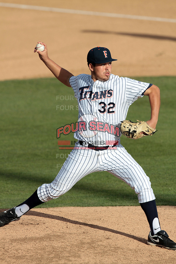 Koby Gauna #32 of the Cal State Fullerton Titans pitches against the Loyola Marymount Lions at Goodwin Field on February 29, 2012 in Fullerton,California. Cal State Fullerton defeated LMU 6-2.(Larry Goren/Four Seam Images)