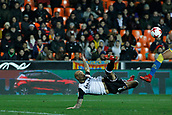 9th January 2018, Mestalla Stadium, Valencia, Spain; Copa del Rey football, round of 16, second leg, Valencia versus Las Palmas; Simone Zaza Italian striker for Valencia CF tries an overhead shot during the game