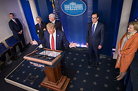 United States President Donald J. Trump delivers remarks on the COVID-19 (Coronavirus) pandemic alongside US Vice President Mike Pence and members of the Coronavirus Task Force in the Brady Press Briefing Room at the White House in Washington, DC, March 25, 2020, in Washington, D.C. <br /> Credit: Sarah Silbiger / Pool via CNP/AdMedia