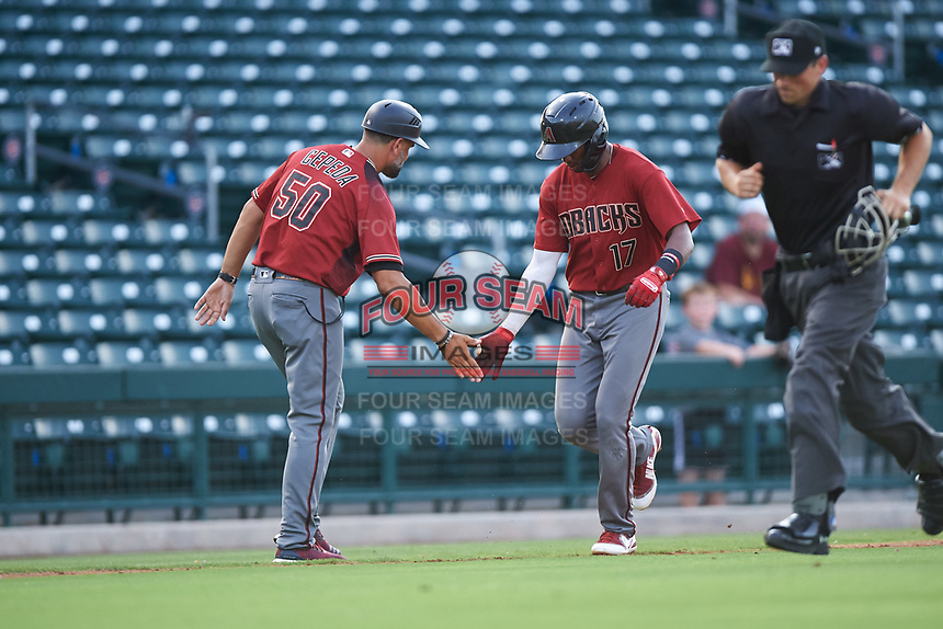 AZL D-backs Neyfy Castillo (17) is congratulated by Wellington Cepeda (50) after hitting a home run during an Arizona League game against the AZL Cubs 1 on July 25, 2019 at Sloan Park in Mesa, Arizona. The AZL D-backs defeated the AZL Cubs 1 3-2. (Zachary Lucy/Four Seam Images)