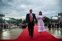 """U.S. President Donald Trump waves with first lady Melania Trump during the Fourth of July Celebration 'Salute to America' event in Washington, D.C., U.S., on Thursday, July 4, 2019. The White House said Trump's message won't be political -- Trump is calling the speech a """"Salute to America"""" -- but it comes as the 2020 campaign is heating up. <br /> h<br /> CAP/MPI/CNP<br /> ©CNP/MPI/Capital Pictures"""