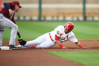 Springfield Cardinals outfielder Charlie Tilson (8) slides into second as Drew Robinson attempts to tag during a game against the Frisco RoughRiders  on June 3, 2015 at Hammons Field in Springfield, Missouri.  Springfield defeated Frisco 7-2.  (Mike Janes/Four Seam Images)
