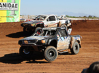 Apr 16, 2011; Surprise, AZ USA; LOORRS driver Brent Fouch (21) and Jeffrey Kargola (2) during round 3 at Speedworld Off Road Park. Mandatory Credit: Mark J. Rebilas-.