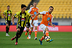 Wellington Phoenix&rsquo; Logan Rogerson and Brisbane&rsquo;s Jack Hingert in action during the A League - Wellington Phoenix v Brisbane Roar FC at Westpac Stadium, Wellington, New Zealand on Sunday 25 March 2018.<br /> Photo by Masanori Udagawa. <br /> www.photowellington.photoshelter.com