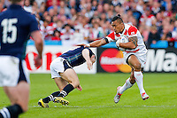 Japan Outside Centre Male Sa'u is tackled by Scotland Outside Centre Mark Bennett - Mandatory byline: Rogan Thomson - 23/09/2015 - RUGBY UNION - Kingsholm Stadium - Gloucester, England - Scotland v Japan - Rugby World Cup 2015 Pool B.