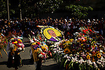 "A garlands of flowers with the face of Colombian painter Fernando Botero attend the traditional ""Silletero"" parade during the Flower Festival in Medellin August 7, 2012. Photo by Eduardo Munoz Alvarez / VIEW."