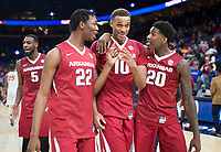 NWA Democrat-Gazette/CHARLIE KAIJO Arkansas Razorbacks forward Gabe Osabuohien (22), forward Daniel Gafford (10) and forward Darious Hall (20) react after winning the Southeastern Conference Men's Basketball Tournament quarterfinals, Friday, March 9, 2018 at Scottrade Center in St. Louis, Mo. Arkansas Razorbacks defeated Florida Gators 80-72