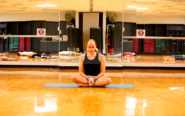 Kinesiology senior Patrick Sims leads exercises during the yoga class held at the Johnson Center on Monday. .Photo by Zach Brake   Staff