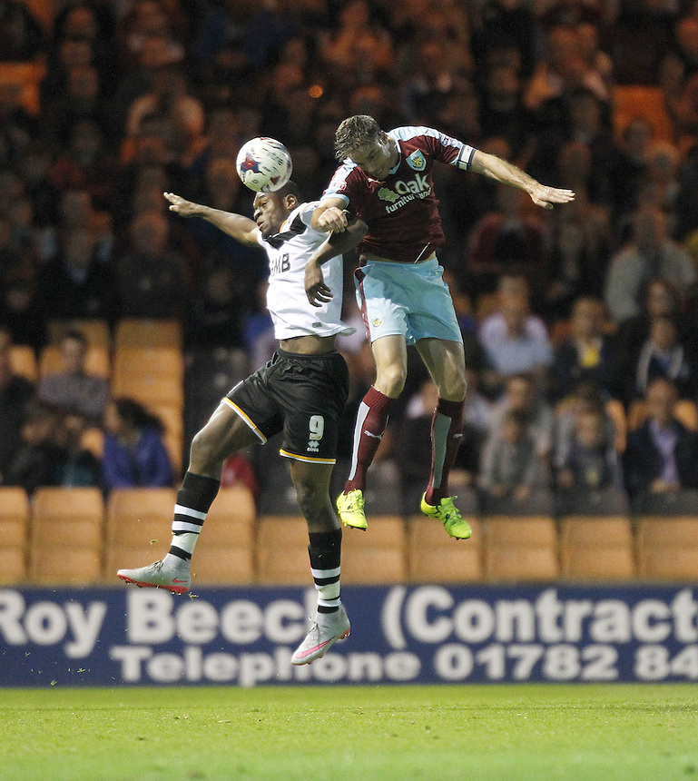 Burnley's Matthew Taylor jumps with Port Vale's Uche Ikpeazu<br />