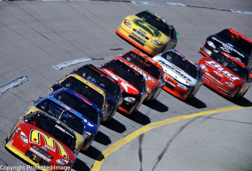 Bill Elliott leads a long line of cars down the frontstretch at Talladega in October 2000 during the Winston 500.(Photo by Brian Cleary)