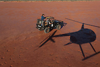 Camel catchers in toyota on desert claypan, aerial, Central Australia, Northern Territory, Australia.