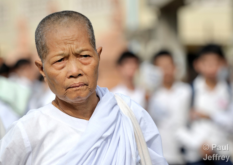 A Buddhist nun participates in a march to commemorate World AIDS Day held in Battambang, Cambodia. Among sponsors of the march was the Salvation Centre Cambodia, an organization that works with Buddhist monks and other activists to foster support for people living with HIV and AIDS as well as public education and advocacy throughout the country.