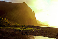 The stunning cliffs of remote Wailau Valley on Molokai glow in the soft golden afternoon light.