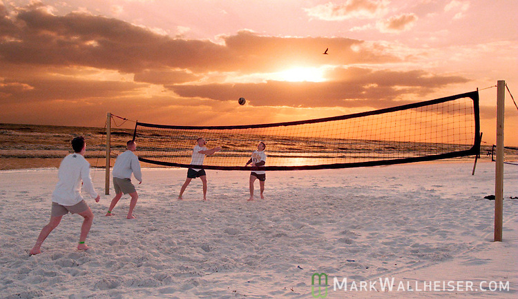 Brian McCarter and Mark Wininger (L)(near court) and Tim Luttrell and Chad Wagner, all frum the University of Tennessee in Knoxville, Tennessee play vollyball during spring break on a deserted Panama City Beach, Florida.   (Mark Wallheiser/TallahasseeStock.com)