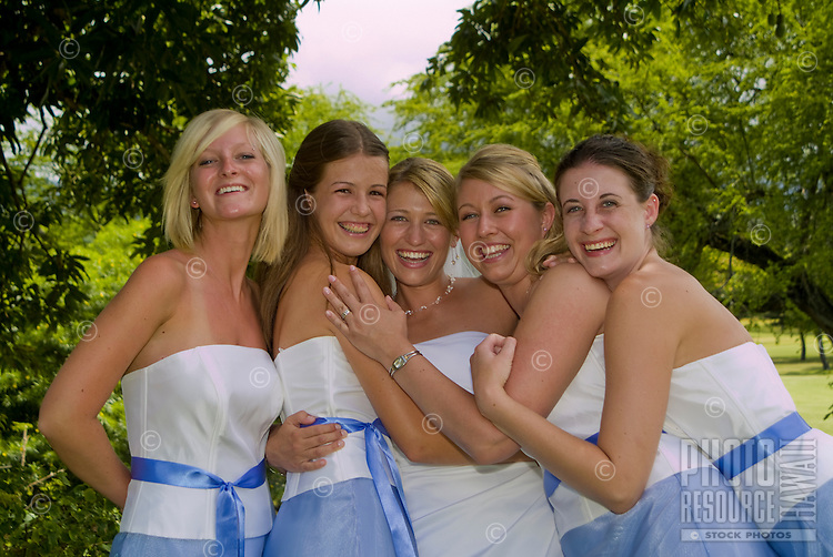 A bride with the women of her wedding party