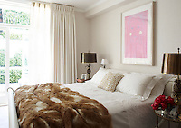 The wall covering and curtains in the master bedroom are of linen and the print is by Gary Hume