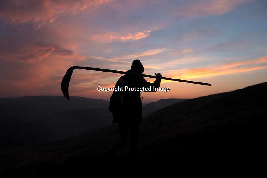 10/05/16 <br /> <br /> A female game keeper sets off across the heather moorland to beat down more flames that broke out shortly after sun down.<br /> <br /> Full story:   http://www.fstoppress.com/articles/peak-district-fire/<br /> <br /> .A small group of gamekeepers spent the night fighting a major blaze blaze covering two hundred acres of heather moorland close to the Derwent and Ladybower reservoirs in the Derbyshire Peak District.<br /> <br /> The fire, which broke out at around 1pm on Monday, is believed to have been started by a disposable barbecue, according to a spokesman for the reservoir, which quickly escalated into a major fire threatening the natural habitat of many wild animals and birds including red grouse, plovers, meadow pipits and hen harriers.<br /> <br /> Ten fire crews were called to tackle the flames, and remained on scene until dusk fell, leaving the job of managing the fire overnight to the gamekeepers on scene.<br /> <br /> Kieran Logan was one of the gamekeepers left battling the flames and he said moorland management policies implemented some 10 years ago by the landowners, The National Trust were also partly to blame.<br /> <br /> All Rights Reserved: F Stop Press Ltd. +44(0)1335 418365   +44 (0)7765 242650 www.fstoppress.com