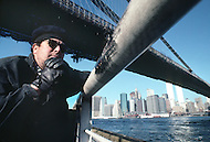 Brooklyn, New York - October 6, 1988. French designer and architect Philippe Starck, takes a stroll underneath the Brooklyn Bridge.