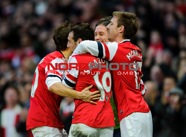 Arsenal Midfielder Santi Cazorla (ESP) celebrates with teammates after scoring a goal during the match -  - 18/01/14 - SPORT - FOOTBALL - Emirates Stadium - Arsenal v Fulham - Barclays Premier League.<br /> Foto nph / Meredith<br /> <br /> ***** OUT OF UK *****
