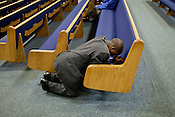 A parishioner  of the Upper Room Church of God in Christ prays before the start of a Bible study group lead by Rev. Patrick Wooden, Raleigh, North Carolina, Thursday, August 30, 2012. Rev. Wooden opposes President Obama and his support of same sex marriage, an issue that has the potential to sway the African-American vote in a vital swing state. .