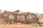 Road signs on a stone, giving directions to various safari camps and park exists  in Tsavo  East National Park, Kenya