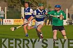 Lady's Walk Mike Hennessy keeps his concentration as St Brendan's Billy O'Connell chases hard in the NK Intermediate Hurling Final at the Kilmoyley Hurling Club grounds on Monday night..   Copyright Kerry's Eye 2008