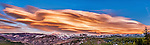 A panorama photo of a lenticular cloud above the Sierra mountains. 100 mph winds aloft created this dramatic cloud.