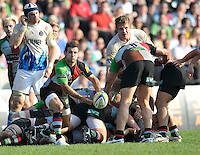 London, England. Danny Care of Harlequins clears the ball during the Aviva Premiership match between Harlequins and Bath Rugby at Twickenham Stoop on March 24, 2012 in Twickenham, England.