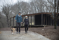NWA Democrat-Gazette/SPENCER TIREY Joel Raymond and Suzie Atkin walk the trail through Coler Mountain Bike Preserve South Gateway Sunday March 24, 2019 in Bentonville. The new pavilion and parking area is still under construction.