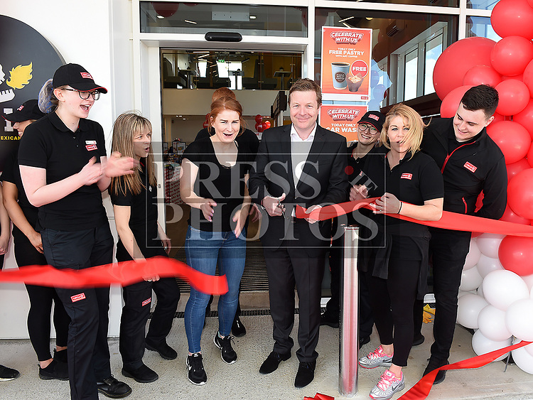 RTE Sports presenter Darragh Maloney cuts the ribbon to officially open Circle K at City North pictured with Regional Manager Natasha Fox and Manager Elaine Brennan. Photo:Colin Bell/pressphotos.ie
