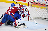 April 28, 2007; Hamilton, ON, CAN; Hamilton Bulldogs centre (31) Mikhail Grabovski tries to get a shot on goal as Rochester Americans defenceman (3) Jeremy Swanson pushes him into goalie (30) Craig Anderson in game six of the AHL north division semifinal at Copps Coliseum. The Bulldogs defeated won 6-2 and eliminated the Americans from the playoffs. Mandatory Credit: Ron Scheffler, Special to the Spectator. (File number RRSA7730).